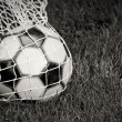 Soccer Ball in the Net - B&W - Stock Photo