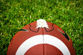 American Football On Grass — Stock Photo