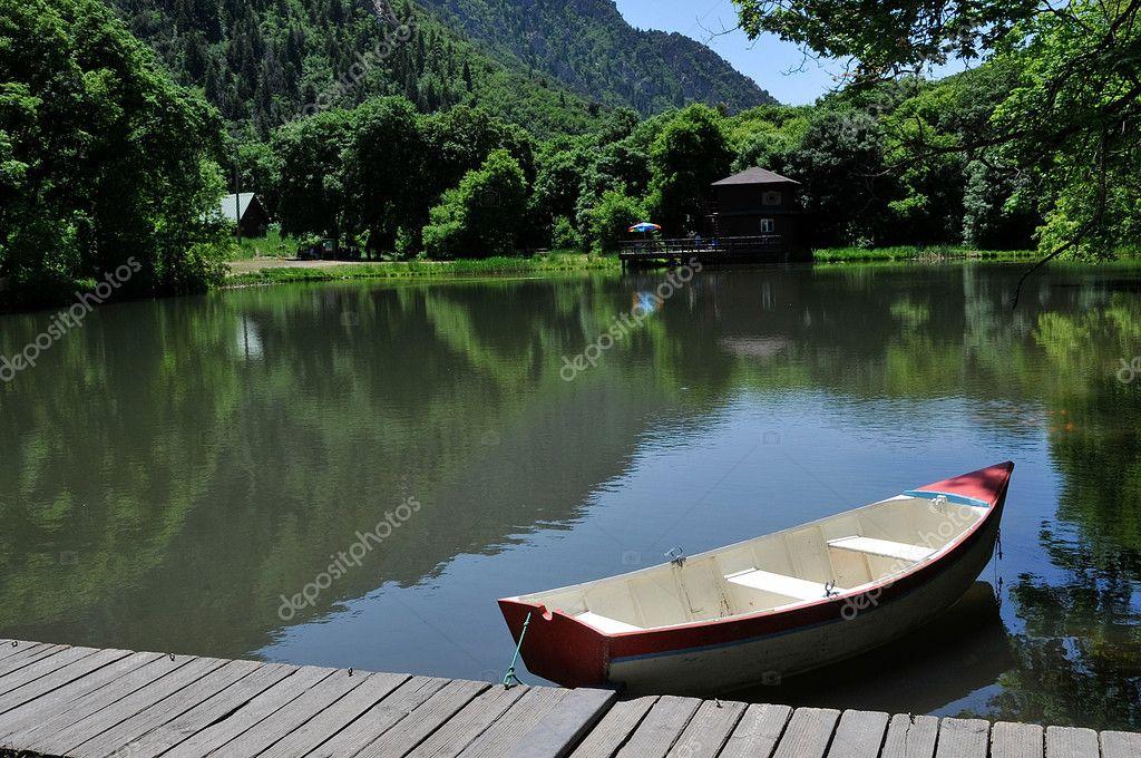 Boat on Pond — Stock Photo © bhaslam #2372068