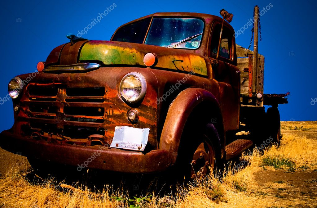 Old truck in a field, high contrast, bright colors  Stock Photo #2372116