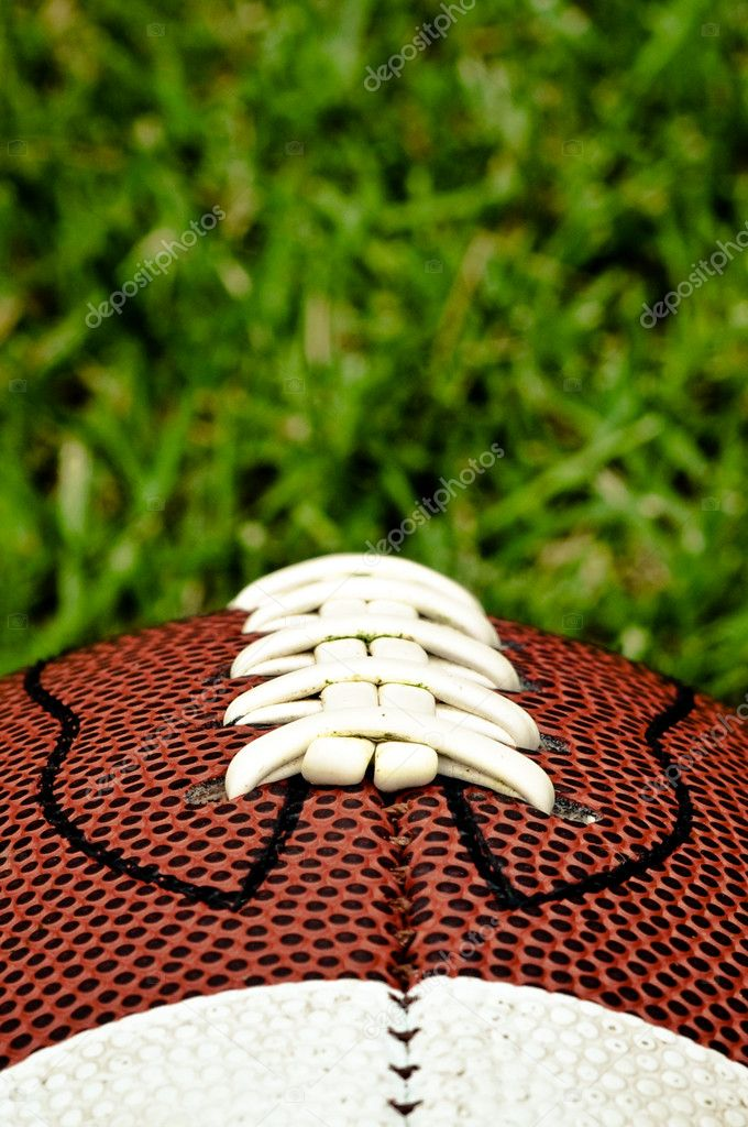 American football on grass close up of laces  Stok fotoraf #2372128
