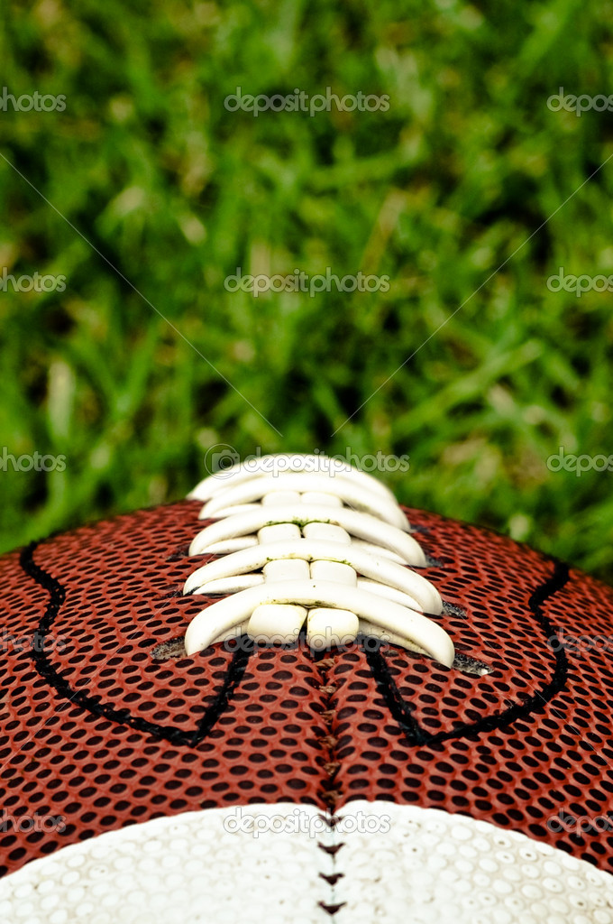 American football on grass close up of laces — Zdjęcie stockowe #2372128