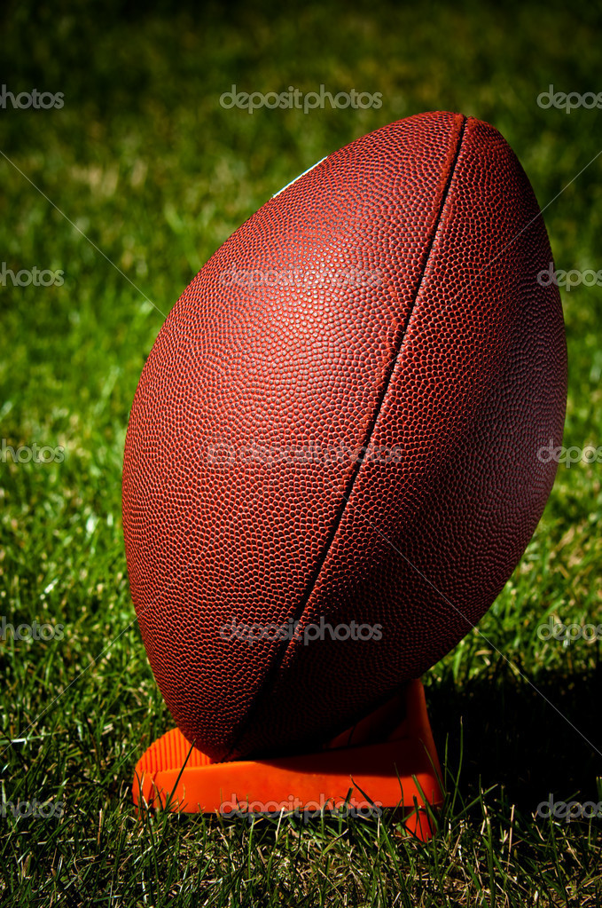 American Football on a tee seen from the side — Stock Photo #2372301