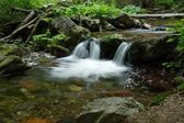 Waterfall on mountains river — Stock Photo