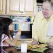 Elderly man sharing cookies - Foto de Stock  
