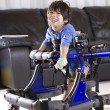 Disabled child in walker - Stock Photo