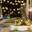 Royalty-Free Stock Photo: Gold ribbon gift on table