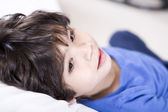 Handsome little boy resting quietly — Stock Photo