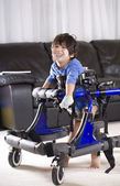 Disabled child in walker — Stock Photo