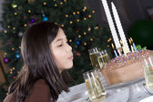 Little girl blowing birthday cake — Stock Photo
