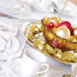 Bowl of red and gold ornaments - 