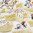 Frosted cake pieces with sprinkles — Stock Photo