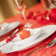 Elegant Christmas table setting in red - Stock Photo