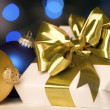 Gold present and ornament — Stock Photo