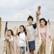 Stock Photo: Four siblings by the lakeshore