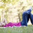 Little girl lying on grass — Stock Photo
