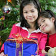 Two little girls with Christmas presents — Стоковая фотография