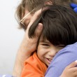 Son hugging his father — Stock Photo #2632463