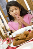 Girl praying during dinner — Stock Photo