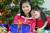 Two little girls with Christmas presents — Stok fotoğraf