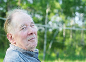 Elderly man enjoying outdoors — Stock Photo
