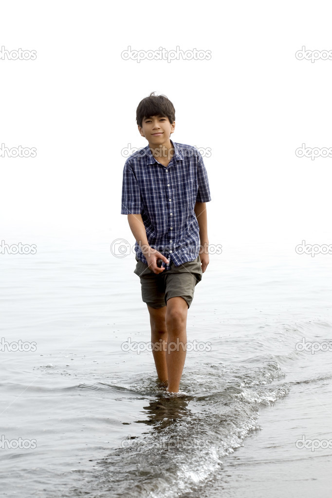 depositphotos 2632446 Young teen boy wading along beach Teens can check out gaming consoles and devices for use in the teen area ...