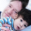 Father and son resting in bed — Stock Photo