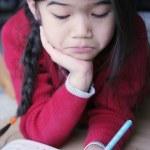 Little girl doing homework — Stock Photo