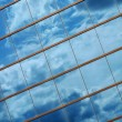 Beautiful clouds reflected in windows — Stock Photo