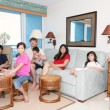 Family relaxing in living room - Stock Photo