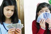 Girls playing cards, one is cheating — Stock Photo