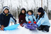 Four kids enjoying winter — Stock Photo
