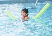 Little girl swimmnig in pool — Stock Photo