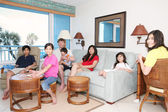 Family relaxing in living room — Stock Photo