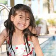 Stock Photo: Little girl at pool