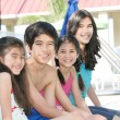 Four children by the pool side — Stock Photo