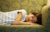 Little girl asleep on couch — Stock Photo