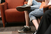 Legs of two teenage couple — Stock Photo