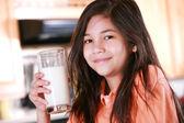 Child holding glass of milk — Stock Photo