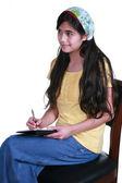Teenage girl taking notes — Stock Photo