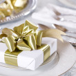 Elegant table set with present as focus - Stock Photo