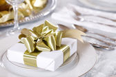 Elegant table set with present as focus — Stockfoto