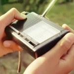 Turning on the Portable radio — Stock Photo