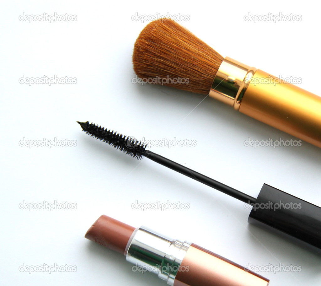 Brush for a make-up, brush for eyelashes and lipstick on a white background  Stock Photo #2242659
