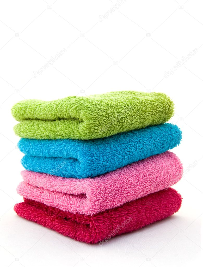 Stack of colorful towels on a white background  — Stock Photo #2248911