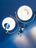 White lightening on blue wall — Stock Photo