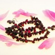 Garnet beads on a white background — Stock Photo
