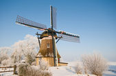 A mill in a winter landscape — Stock Photo