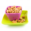 Colored bowl with cashew nuts - Stock Photo