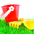 Stock Photo: Sandpit toys on green grass